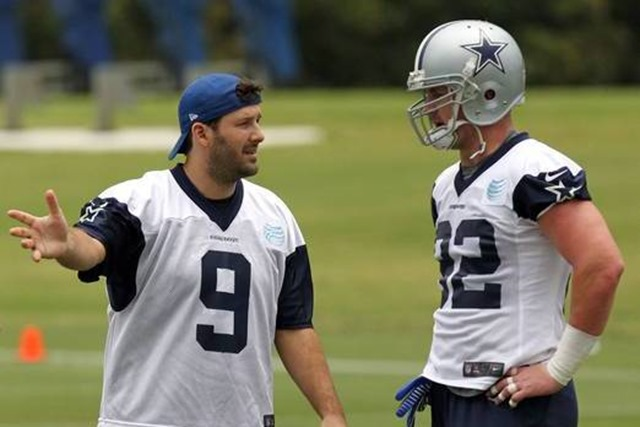 Dallas Cowboys quarterback Tony Romo directs teammate Jason Witten as he runs a pass route - The Boys Are Back blog 2013