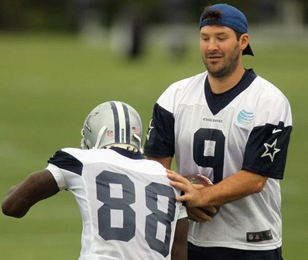 Dallas Cowboys quarterback Tony Romo tries not to collide with Dez Bryant as he runs a pass route - The Boys Are Back blog 2013