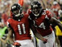 Jan 20, 2013; Atlanta, GA, USA; Atlanta Falcons wide receiver Julio Jones (11) celebrates a touchdown catch against the San Francisco 49ers with wide receiver Roddy White (84)  during the second quarter of the NFC Championship game at the Georgia Dome. Mandatory Credit: Dale Zanine-USA TODAY Sports