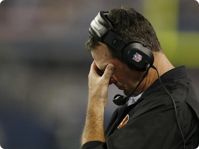 Cincinnati Bengals defensive coordinator Mike Zimer shows his frustration with his defense against the Dallas Cowboys