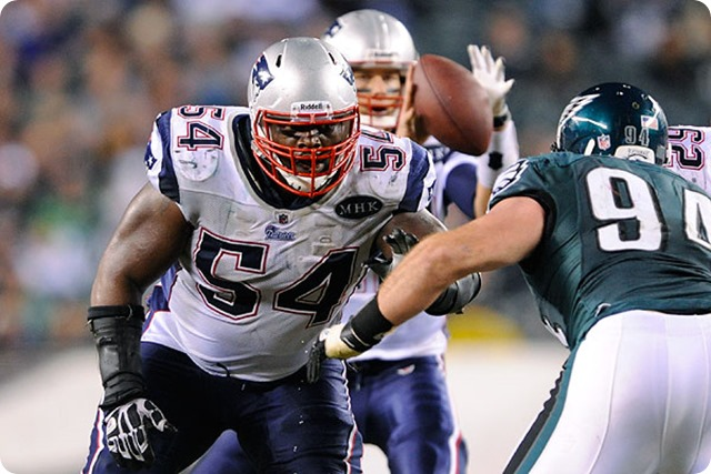 Nov 27, 2011; Philadelphia, PA, USA; New England Patriots guard Brian Waters (54) looks to block Philadelphia Eagles defensive tackle Derek Landri (94) during the fourth quarter at Lincoln Financial Field. The Patriots defeated the Eagles 38-20. Mandatory Credit: Howard Smith-USA TODAY Sports