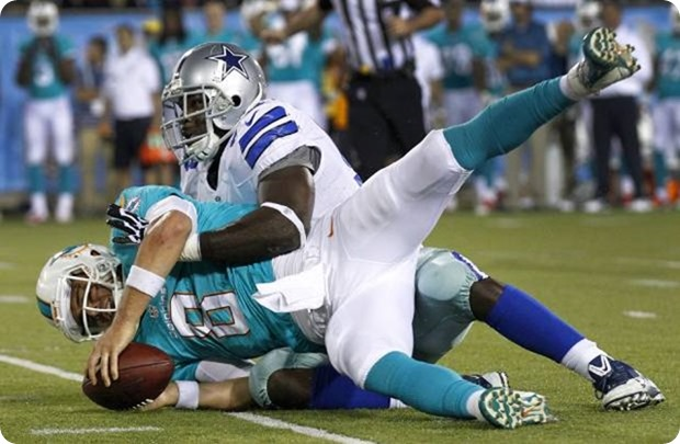 Dallas Cowboys defensive end George Selvie sacks Miami Dolphins quarterback Matt Moore - The Boys Are Back blog 2013