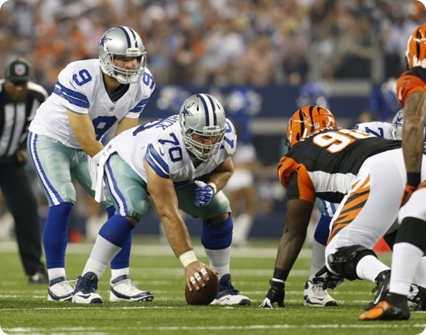 Tony Romo behind center Travis Frederick