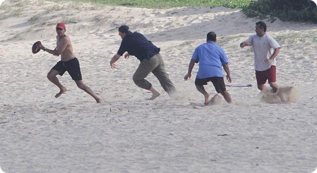 Barack Obama playing football