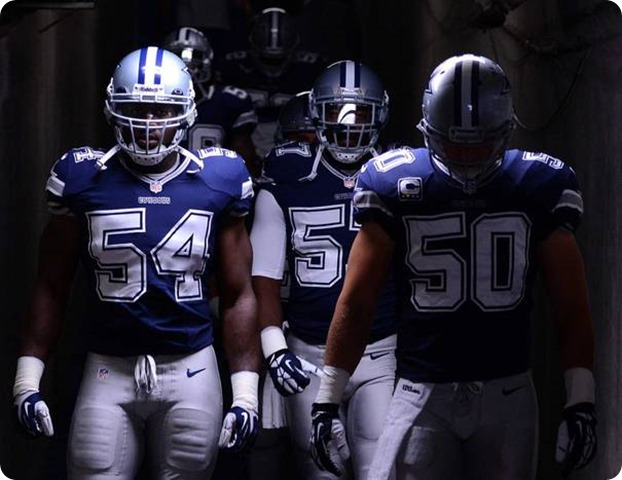 Bruce Carter #54 and Sean Lee #50 of the 2013-2014 Dallas Cowboys walk down the tunnel to play San Diego Chargers