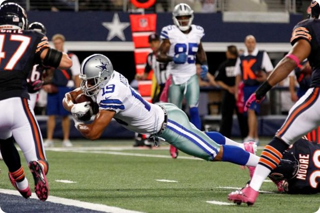 dallas cowboys wide receiver miles austin (19) dives through a tackle by chicago bears cornerback d.j. moore (30) to score a touchdown - the boys are back blog