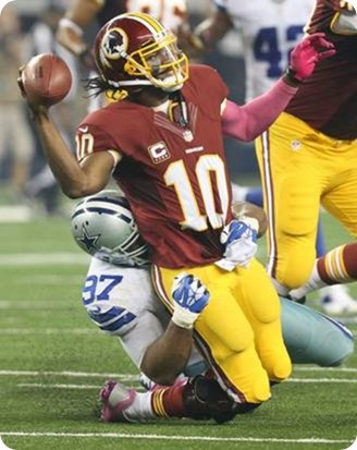 IN THE HEAT OF BATTLE - Jason Garrett likes the passion of the defensive line coach Rod Marinelli - Dallas Cowboys Jason Hatcher's sack Robert Griffin III RG3