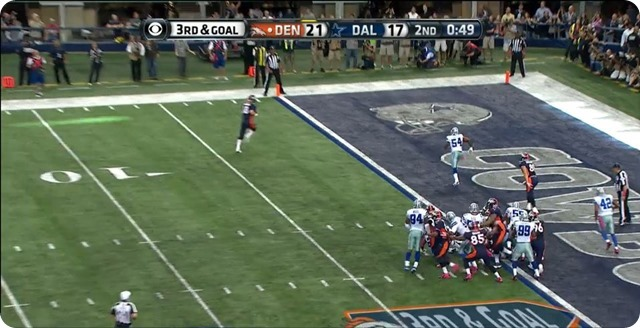 Manning TD - 6 - Carter and Church in pursuit - Manning rolls closer to endzone