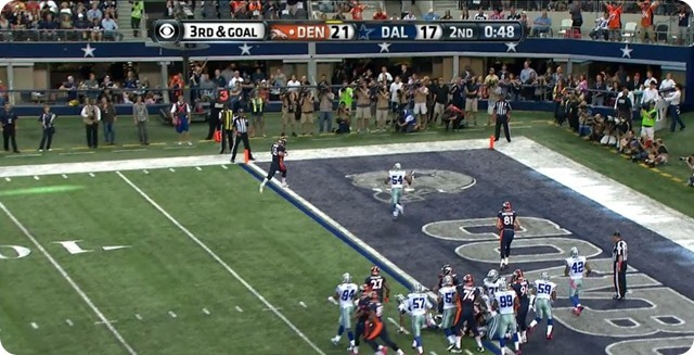 Manning TD - 7 - Carter closes in but delay by WR hold makes stop impossible - Manning crosses into endzone