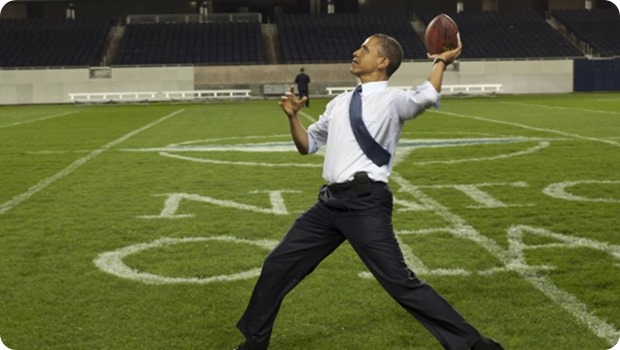 President Barack Obama throws a football at Soldier Field - The Boys Are Back blog
