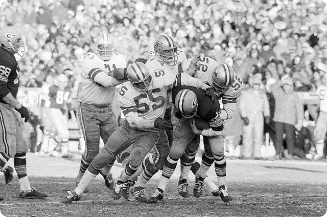 12-30-1967 - Green Bay quarterback Bart Starr is treated roughly as he is thrown for a seven yard loss by the Dallas Cowboy defense
