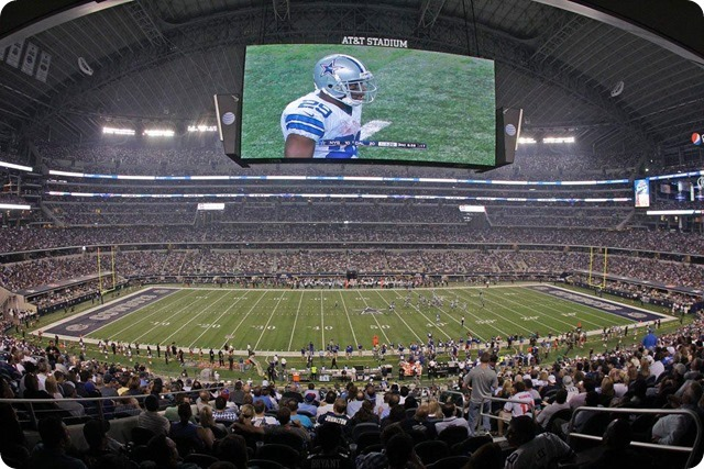 NEW ERA - THE 12th COWPOKE - Rowdy Dallas Cowboys fans create home field advantage at AT&T Stadium - 2013-2013 Dallas Cowboys - Big screen view of DeMarco Murray