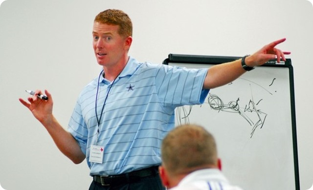 Dallas Cowboys coach Jason Garrett teaching in classroom with players