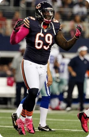 chicago bears defensive tackle henry melton (69) celebrates after sacking dallas cowboys quarterback tony romo - the boys are back blog