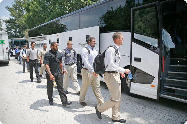 THE BOYS ARE BACK - Dallas Cowboys arrive at Naval Base near Oxnard, California - 2014-2015 Dallas Cowboys Training Camp - Team Bus - The Boys Are Back website