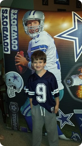 Timothy Tinman Brookshire and his Tony Romo poster - The Boys Are Back website